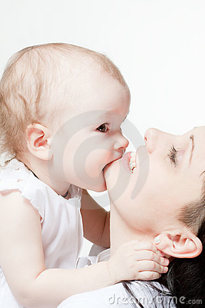 Cute baby biting her mother s chin