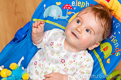 Cute baby on bouncy chair