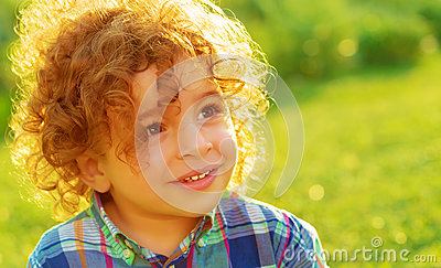 Cute Child Boy In The Field Little Girl With Curly Hair And Green Eyes