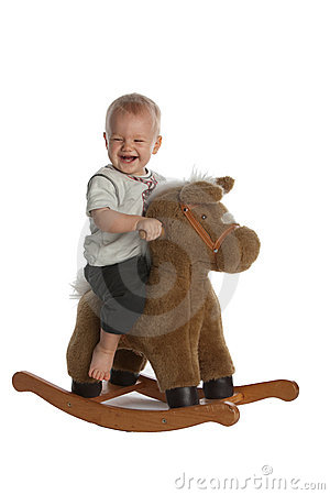 Free Cute Baby Boy Laughing On Rocking Horse Stock Photography - 15412832