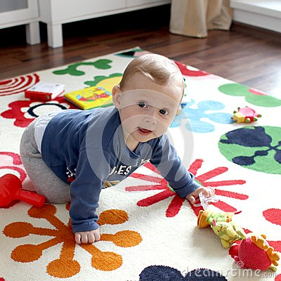 Cute baby boy on play mat