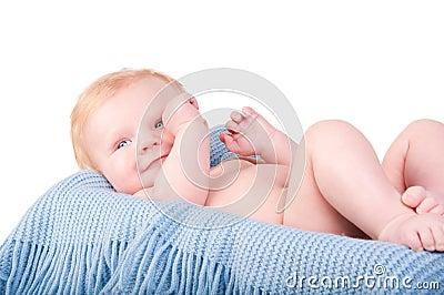 Cute Baby boy s portrait on blue blanket
