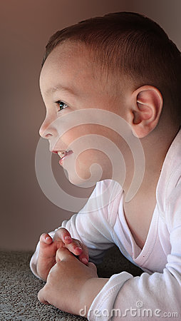 Cute baby boy smiling and looking up