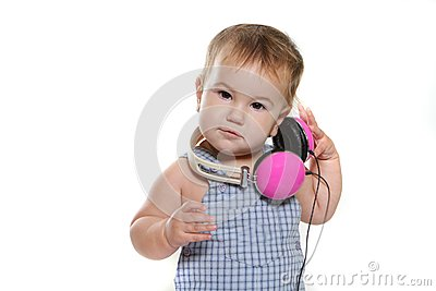 Cute baby child in headset over white