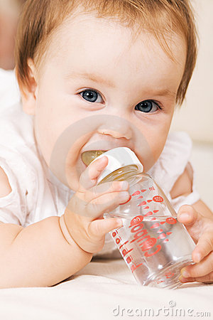 Cute baby drinking water