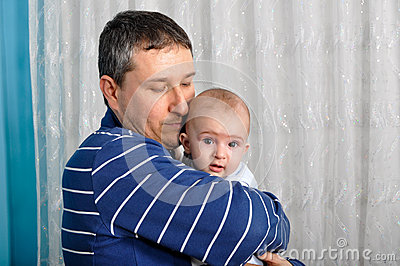 Cute baby and father