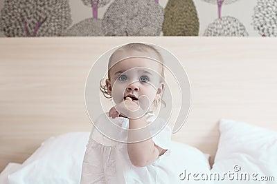 Cute baby girl in bedroom