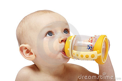 Cute baby girl drinking from bottle with teath