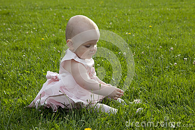 Cute baby girl in grass