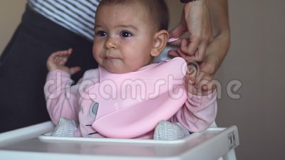 Fabulous Cute Baby Girl In High Chair In Silicone Bib For Food Concept Kitchen Short Links Chair Design For Home Short Linksinfo