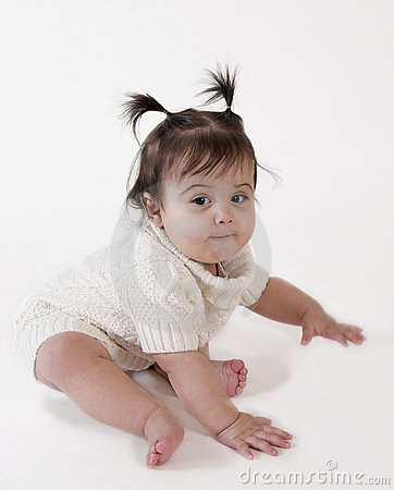 Cute baby girl ready to crawl