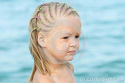 Cute Baby girl on sea