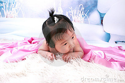Cute baby girl under blanket