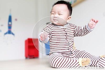 Cute Baby happy close his eyes