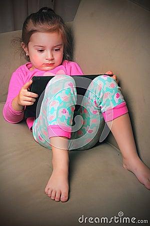 Cute Baby on iPad Stock Photo