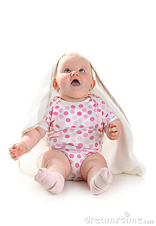 Cute baby looking up in excitement sitting