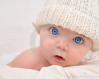 Cute Baby Looking with White Hat