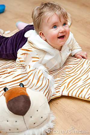 Cute baby playing on rug
