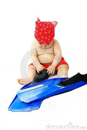 Cute baby putting on flippers