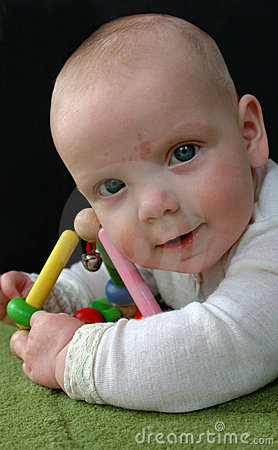 Cute baby with rattle