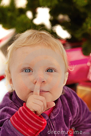Cute baby saying shhh - at christmas