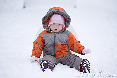 Cute baby sit on fresh snow in park