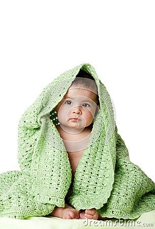 Free Cute Baby Sitting Between Green Blanket. Stock Image - 14325881