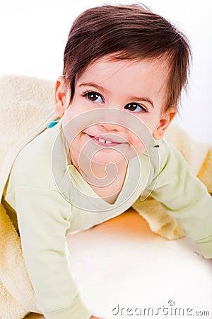 Cute baby smile under yellow blanket