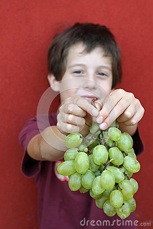 Free Cute Baby Who Kindly Offers Grapes Stock Photos - 34058243
