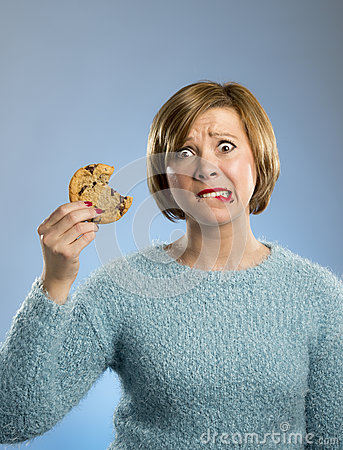 Free Cute Beautiful Woman With Chocolate Stain In Mouth Eating Big Delicious Cookie Royalty Free Stock Photo - 81750555