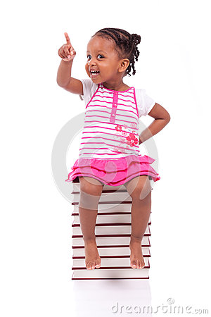 Free Cute Black African American Little Girl Seated In A Stack Of Boo Stock Images - 31066474
