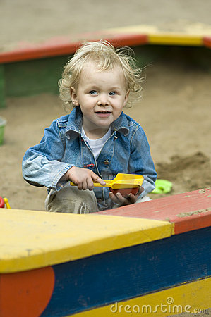 Cute Blond Child Playing in Sandbox