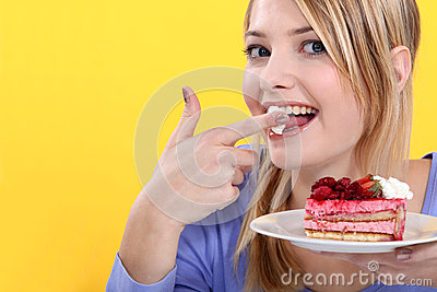 Cute blond eating a cake.