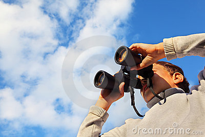 Cute boy with binoculars outdoor