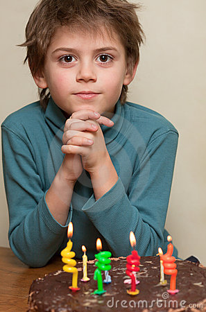 Cute boy at birthday cake