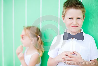 Cute boy with bow tie party accessory