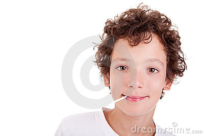 Cute Boy with a candy on mouth smiling