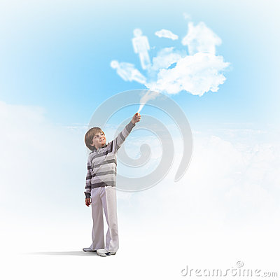 Cute boy catching clouds