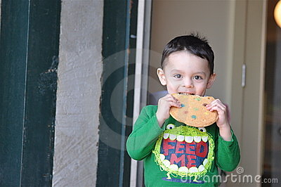 Cute Boy Enjoying a Cookie