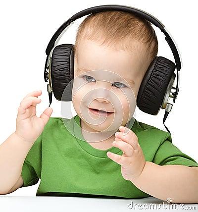 Free Cute Boy Enjoying Music Using Headphones Stock Image - 23375561