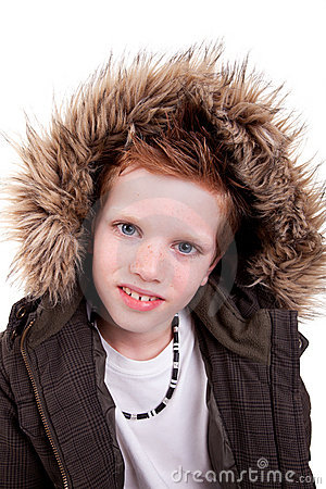 Cute boy with a furry hood