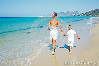Cute boy and girl on the beach