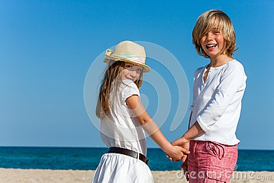 Cute boy and girl holding hands.