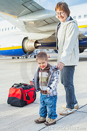 Cute boy and his grandmother prepared to fly