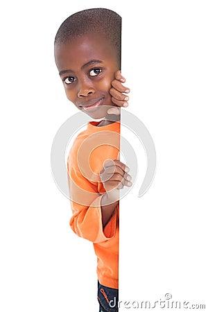 Free Cute Boy Looking Around Corner Stock Images - 57333884