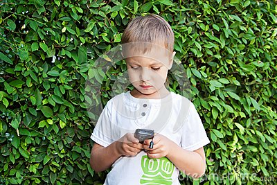 Cute boy with mobile phone