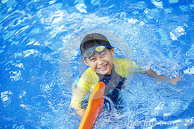 Cute boy playful on the pool