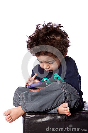 Cute boy playing games on mobile device