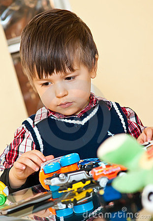 Cute boy playing with toys