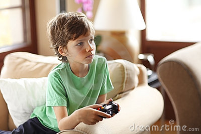 Cute boy playing video games